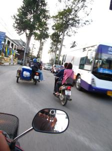 Assortment of vehicles share the road
