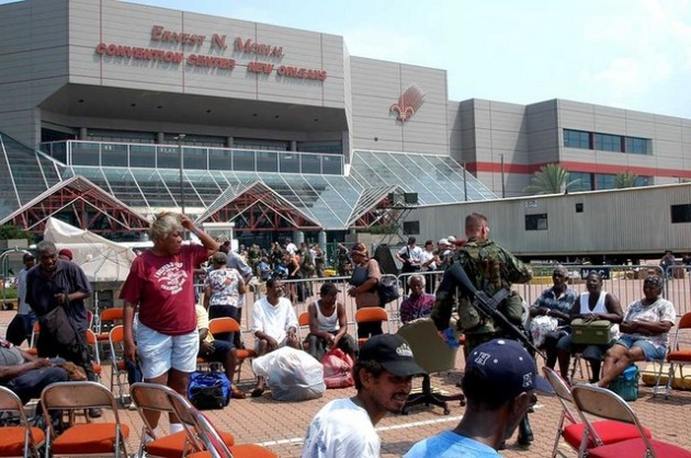 New Orleans, September 5, 2005 - The large group of individuals gathered at the Ernest N. Morial Convention Center in the downtown area slowly thins as helicopters ferry them from here to the New Orleans Airport.  Once treated, all these evacuees will be going to shelters and hospitals across the United cStates.  Photo by Win Henderson / FEMA photo.