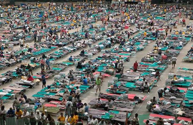 Thousands of hurricane Katrina survivors from New Orleans are bussed to refuge at a Red Cross shelter in the Houston Astrodome.FEMA photo/Andrea Booher