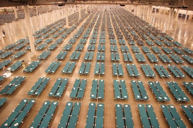 Cots are set up in the Reliance Center to provide additional housing for people bussed from New Orleans in the FEMA organized program.  The Red Cross provided a special package for each cot.  Photo by Ed Edahl/FEMA